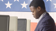A young man in a voting booth, side view Stock Footage