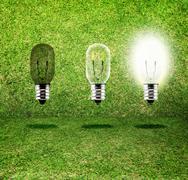 Sequence of Creative idea,three bulb in grass room,eco idea Stock Photos