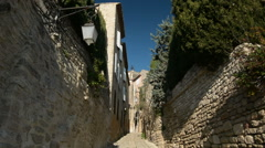 Narrow cobbled street in downtown Gordes, Provence, France, tilt Stock Footage