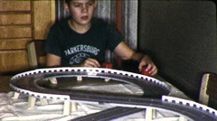 Little Boy Plays With Slot Cars Toy Racer 1960s Vintage Film Home Movie 9912 Stock Footage