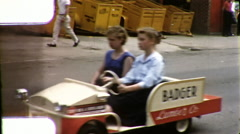 Go Kart Kids Soapbox Cars Parade Police Bread truck Vintage Film Home Movie 9879 Stock Footage