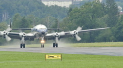 Historic Airliner Breitling Lockheed L-1049 Super Constellation (Connie) Lands Stock Footage