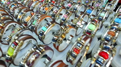 Leather handmade souvenir bracelets at the street market - shopping backgroun Stock Footage