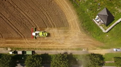 Aerial view - harvesting a field, combine harvester Stock Footage