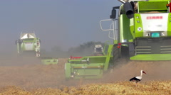 Agricultural machinery in the work of the harvest Stock Footage