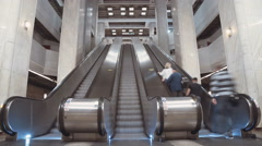 Time Lapse of people riding escalators in a metro station Stock Footage