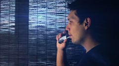 Man is vaping in slow motion Stock Footage