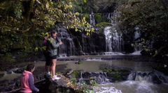Tourist at Purakaunui Falls, located in the Catlins, New Zealand. Stock Footage
