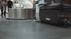 Conveyor belt at the airport with luggage Stock Footage