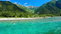 Pan Up Time-Lapse Turquoise Kamikochi River Mountain Clouds Kamikochi Japan Stock Footage