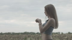 Young Beautiful Woman Stretching Muscles During Outdoor Workout Stock Footage