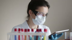 Laboratory Assistant with Test-tubes and Tablet Stock Footage