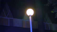 Lantern in the night - flashing light spot rays lumiere and blinking in the Stock Footage