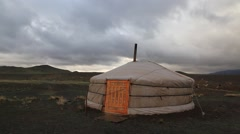 Yurt in the steppe under the rain clouds. Mongolia. Stock Footage