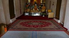 golden buddha statue in buddhism pagoda - stock footage