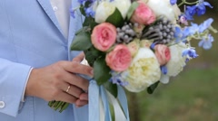 Bridal Bouquet Of Flowers In Hands Of The Groom Stock Footage