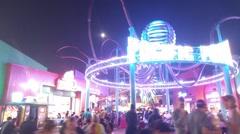 Hyperlapse POV walk through crowd at Santa Monica Pier at night 4K UHD Stock Footage