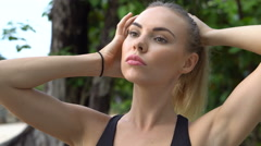 Fitness pretty blonde woman on tropical beach during beautiful summer day Stock Footage
