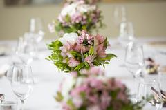 Wedding banquet table flower decoration in a restaurant Stock Photos