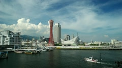 View of Kobe bay with Port Tower blue sky and speed boat. 2016 - stock footage
