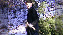 Kids Boy Cutting Down Christmas Tree Chopping 1960s Vintage Film Home Movie 9829 Stock Footage