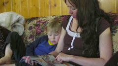 Mother reads to child Stock Footage