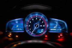 Modern car instrument dashboard panel or speedometer in night time Stock Photos