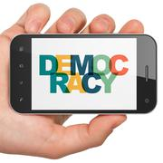 Political concept: Hand Holding Smartphone with Democracy on  display Stock Illustration