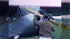 Man Pilot Hand Starts Propeller Plane Engine 1960s Vintage Film Home Movie 9936 Stock Footage