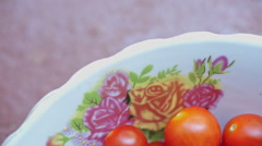 Tomatoes are on the plate Stock Footage