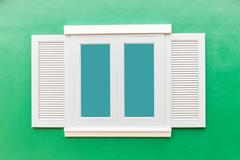White window classic vintage on the color green wall background Stock Photos