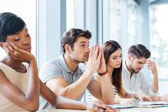 Group of tired bored people on business meeting in office Stock Photos