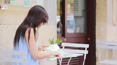 Young european woman with citymap in outdoors cafe. Portrait of attractive young Stock Footage