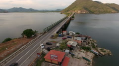 Small houses for fishers. Highway and railroad bridge across Skadar lake, Mng Stock Footage