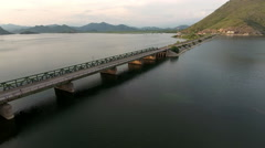 The Skadar lake and dam with railway and highway to Podgorica. Aerial view Stock Footage