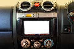 Interior detail of modern luxury car dashboard with big display and alarm Kuvituskuvat