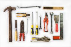 Various old craftsman tools on white background Stock Photos