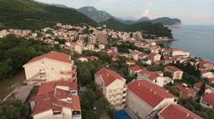 Dwelling district of Petrovac town with red roofs of an apartment houses Stock Footage