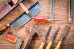 Old & grunge set of hand tools many for carpentry on wood floor background Stock Photos