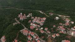 Camera flying to Adriatic highway (Jadranski put) passing near Petrovac town Stock Footage