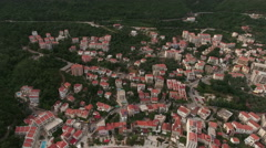 Petrovac cityscape top view with Adriatic highway, city center and shoreline Stock Footage