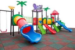 Closeup colorful playground with Prevent injuries yard on isolated white Stock Photos