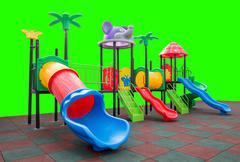 Closeup colorful playground with Prevent injuries yard on isolated green Stock Photos