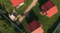 Top view at the village under construction, roofs summer houses, drone flying Stock Footage