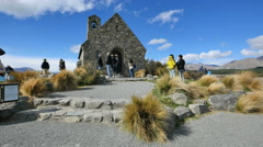 New Zealand historic church with tourists at Lake Tekapo Stock Footage