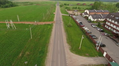 Country asphalt road leads close to townhouse village Kurovo in Moscow region Stock Footage