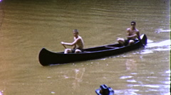 Boys Paddle Canoe Summer Camping Trip 1960s Vintage Film Home Movie 9909 Stock Footage