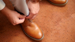 Young man shoe laces - wedding Stock Footage