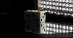 White Dice Reflecting Rotating Around Circle With Light Wall, 4K Stock Footage
