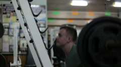 The Athlete in the Gym Doing Squats with a Barbell Arkistovideo